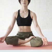 Women have a pose of yoga